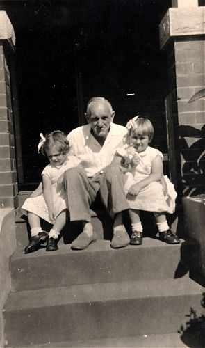 Poppa and his grand-daughters in their Sunday best